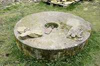 Millstone lying on the ground